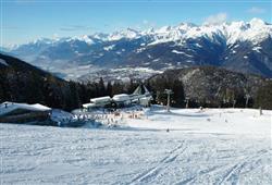 Hotel Urri - 6denní lyžařský balíček s denním přejezdem a skipasem v ceně***24
