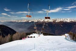 Hotel Urri - 5denní lyžařský balíček s denním přejezdem a skipasem v ceně***18