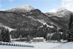 Hotel Sport - 6denní lyžařský balíček s denním přejezdem a skipasem v ceně***3