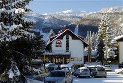 Hotel Sport - 6denní lyžařský balíček s denním přejezdem a skipasem v ceně***13