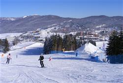 Hotel Sport - 6denní lyžařský balíček s denním přejezdem a skipasem v ceně***20