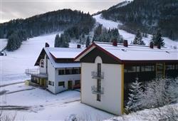 Hotel Sport - 6denní lyžařský balíček s denním přejezdem a skipasem v ceně***1