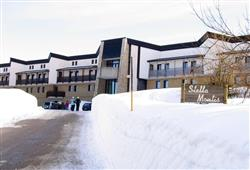 Hotel Stella Montis - 6denní lyžařský balíček s denním přejezdem a skipasem v ceně**1