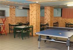 Hotel Stella Montis - 6denní lyžařský balíček s denním přejezdem a skipasem v ceně**16