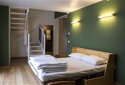 Hotel 1301 Inn - 6denní lyžařský balíček s denním přejezdem a skipasem v ceně***9