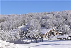 Hotel 1301 Inn - 6denní lyžařský balíček s denním přejezdem a skipasem v ceně***21