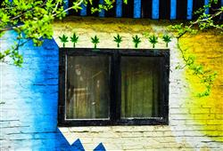 Svérázná čtvrť Christiania, jedno z nejstarších squatterských a hippie sídlišť v Evropě